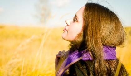Young brunette caucasian woman enjoying the sunlight.